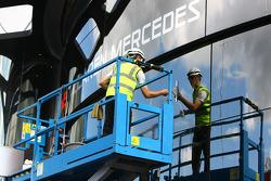 A man cleans the McLaren Mercedes motorhome