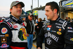 Tony Stewart, driver of the #14 Bass Pro Shops Chevrolet speaks with Casey Mears, driver of the #07 Jack Daniels Chevrolet