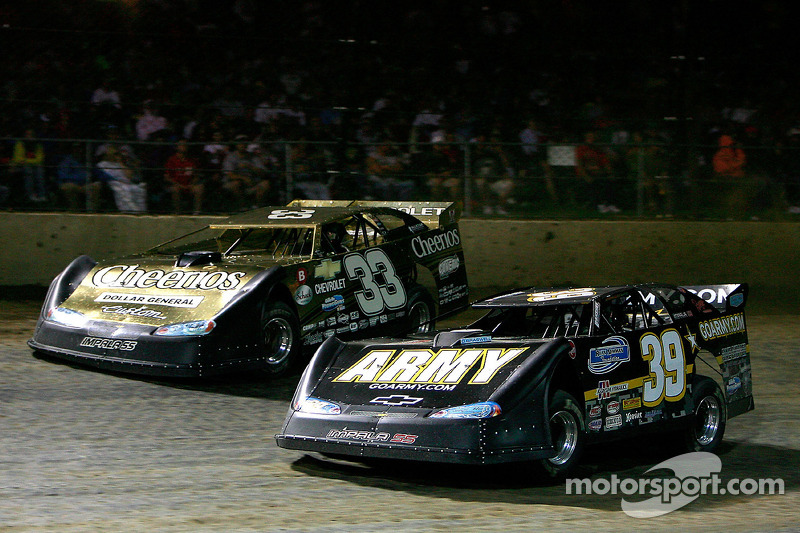 Ryan Newman, driver of the #39 Army Chevrolet leads Clint Bowyer, driver of the #33 Cheerio's Chevrolet