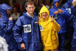 Kelly Ripa poses for a photo with NASCAR Sprint Cup Series driver Kasey Kahne prior to taking part in Largest Custard Pie fight during Guinness World Record Breaker Week on 'LIVE! with Regis and Kelly