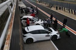 TCR cars in pitlane