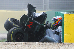 Fernando Alonso, McLaren MP4-31 exits his car after a huge crash
