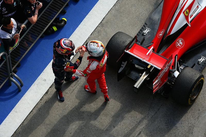 Sebastian Vettel, Ferrari y Daniil Kvyat, Red Bull Racing en parc ferme