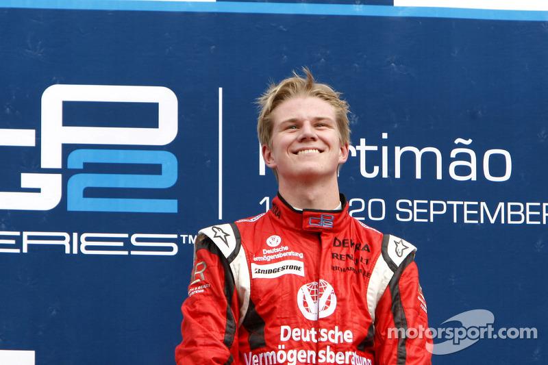 Nico Hulkenberg celebrates his victory on the podium