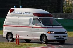 An ambulance takes Jaime Alguersuari, Scuderia Toro Rosso to the medical centre after a crash