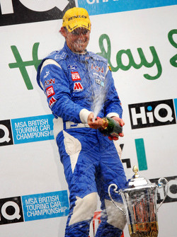 Tom Chilton sprays champagne