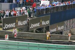 Jarno Trulli, Toyota F1 Team,walks back after crashing with Fernando Alonso, Renault F1 Team and Adr