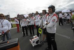 LCR Honda MotoGP team members on the starting grid