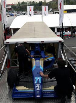 F2 Mechanics load the car of Jack Clarke into the trucks