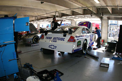 Crew members replace the blown engine on the #34 John Andretti, Earnhardt Ganassi Racing Chevrolet