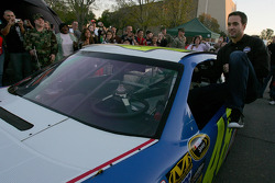 Four-time NASCAR Sprint Cup Champion Jimmie Johnson, Hendrick Motorsports Chevrolet, climbs out of his car to meet with members of the military at Camp Pendelton in Oceanside, California