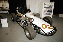 3/4 Midget driven to many victories in the 1960s and 1970s by Bob Dini, Tony Romit and Johnny Coy.  The Crosley engine hangs off the right side, unlike the left for Supermodifieds.