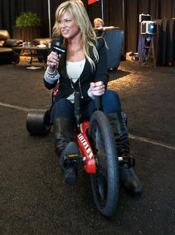TV hostess on a big wheel