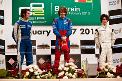 Charles Pic celebrates victory on the podium with Giacomo Ricci and Javier Villa