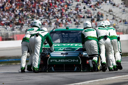 Carl Edwards, Roush Fenway Racing Ford gets pushed back into the garage after an early race wreck