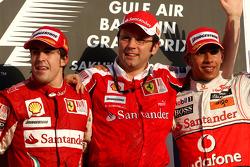 Podium: race winner Fernando Alonso, Scuderia Ferrari, with third place Lewis Hamilton, McLaren Mercedes, and Stefano Domenicali, Scuderia Ferrari Sporting Director