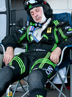 An Extreme Speed Motorsports team member catches a nap