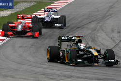Jarno Trulli, Lotus F1 Team leads Timo Glock, Virgin Racing