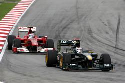 Jarno Trulli, Lotus F1 Team leads Fernando Alonso, Scuderia Ferrari