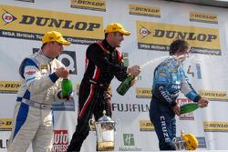 Mat Jackson, Fabrizio Giovanardi and Jason Plato spray champagne