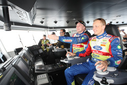 Jari-Matti Latvala and Mikko Hirvonen guide the boat chartered by the organisers to take all the cars and drivers accross the water from the official service park in Pendik