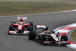 Bruno Senna, Hispania Racing F1 Team leads Felipe Massa, Scuderia Ferrari