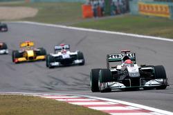 Michael Schumacher, Mercedes GP leads Rubens Barrichello, Williams F1 Team