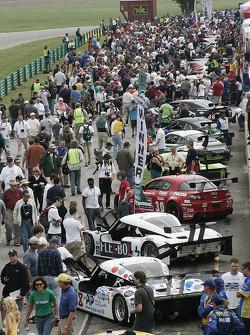 Race fans crowd pit road
