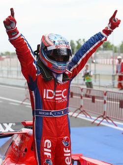 Race winner Charles Pic celebrates