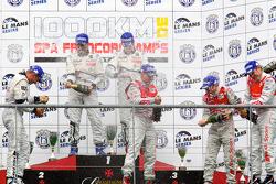 LMP1 podium: class and overall winners Pedro Lamy, Sébastien Bourdais and Simon Pagenaud, second place Franck Montagny, Stéphane Sarrazin and Nicolas Minassian, third place Rinaldo Capello, Tom Kristensen and Allan McNish celebrate with champagne