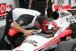 Helio Castroneves, Team Penske receives qualifying instructions from Brian Barnhardt, President of Competition & Racing Operations
