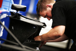 A mechanic works on the car of Pal Varhaug