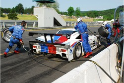 Brumos Racing go to work on the Porsche Riley after contact with the tire barrier in Turn 6