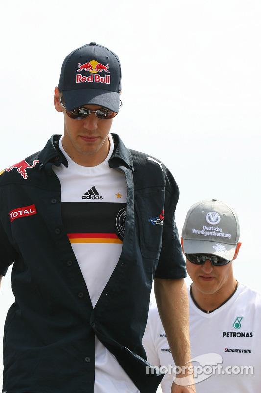 Michael Schumacher, Mercedes GP and Sebastian Vettel, Red Bull Racing