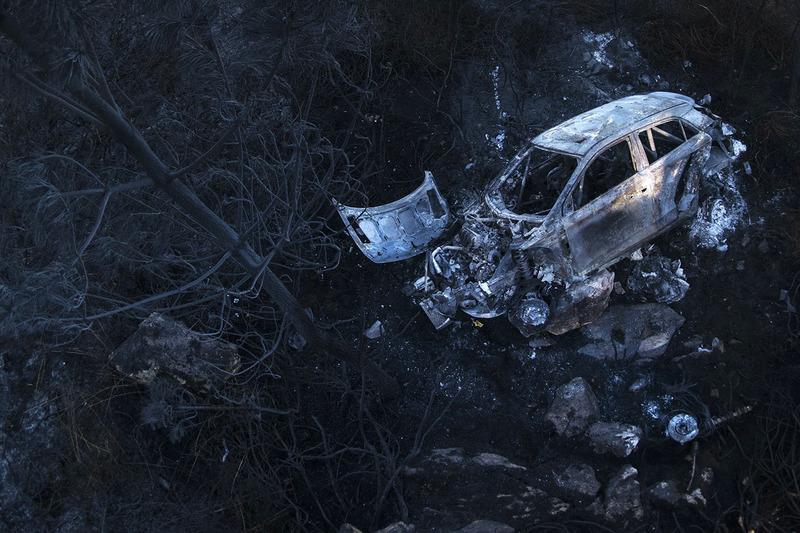 4. Los restos quemados del auto de Hayden Paddon, John Kennard, Hyundai i20 WRC, Hyundai Motorsport