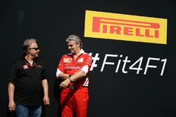 Gene Haas, Haas Automotion President with Maurizio Arrivabene, Ferrari Team Principal