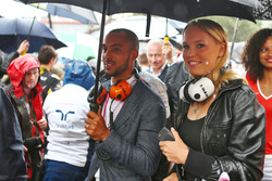 (L to R): Theo Walcott, Football Player and Caroline Wozniacki, Tennis Player, guests of Sahara Force India F1 Team, on the grid
