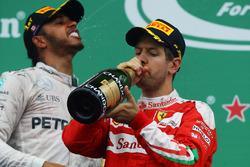 (L to R): Race winner Lewis Hamilton, Mercedes AMG F1 and race winner Sebastian Vettel, Ferrari celebrate on the podium