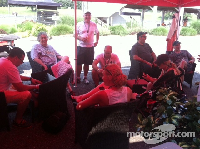 Jim Weiland and his guests relax in the Auto Gallery Motorsports hospitality area