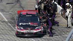 Mark Martin loses a tire and track postition