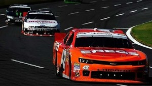Larson holds off the veterans, wins at CMS