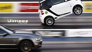 Wild wheelstanding blown Smart car gives Shelby Mustang a scare