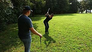 Allmendinger attempts to teach teammate Buescher how to golf