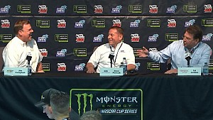 Toyota's Ed Laukes jokes with Chevrolet's Jim Campbell, congratulates him on Xfinity title